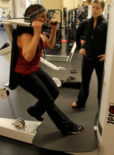 LeAura with personal trainer, Jill Coleman, doing single leg squats.