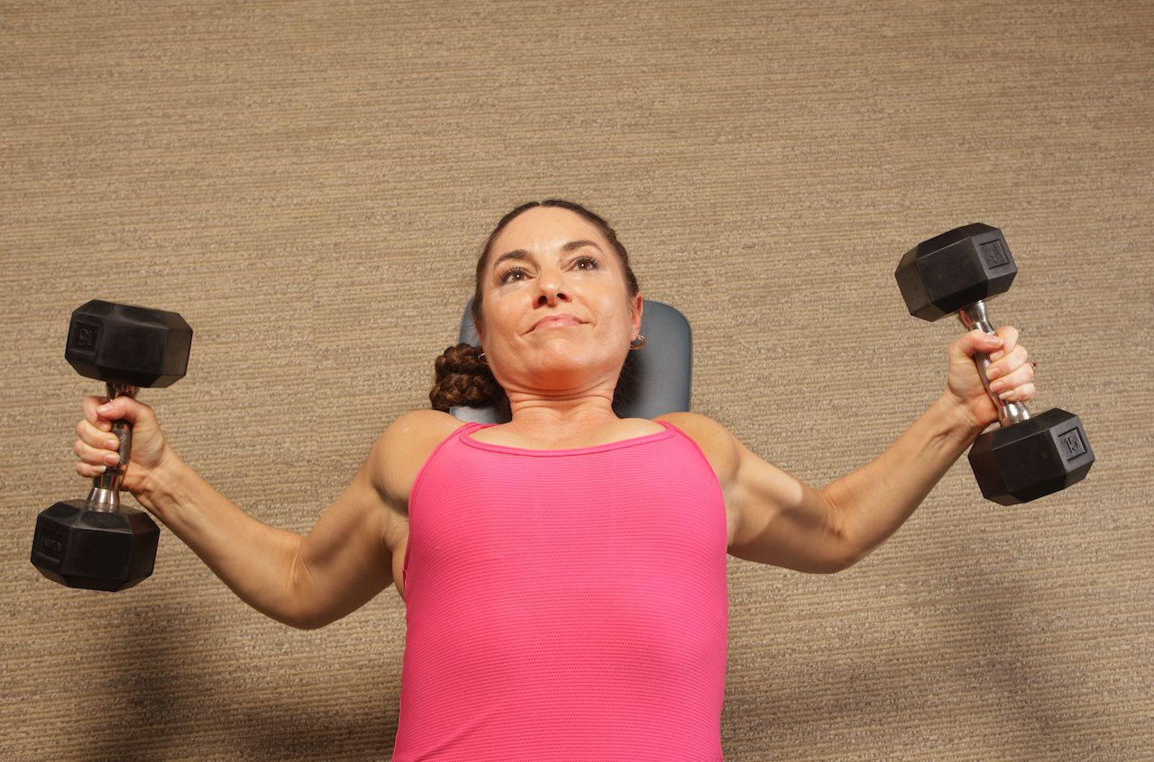 Dumbbell Chest Fly - LeAura Alderson @50 - Image by MyTrainerFitness.com